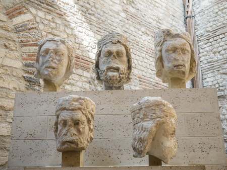 busts: Heads from medieval sculpture from Notre Dame preserved in Cluny Museum in Paris, France