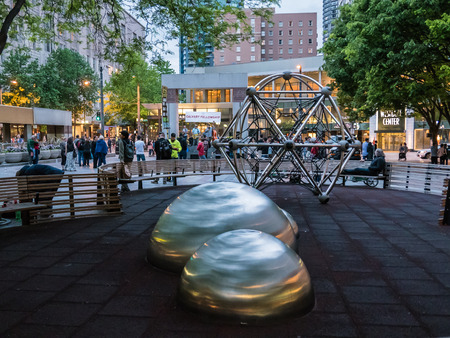 evangelical: An evangelical band serenades public at Westlake Park Seattle with playground in foreground.
