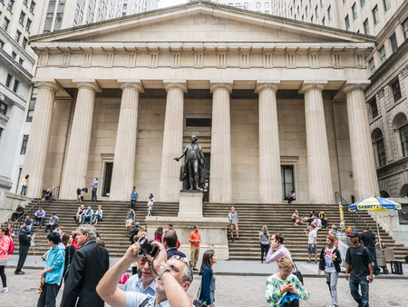 federal hall: New York, NY, June 16, 2015: Federal Hall backdrop for tourists on a summer day. Editorial