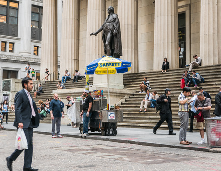 federal hall: New York, NY, June 16, 2015: Food cart and tourists stroll by and lounge on steps of Federal Hall, Lower Manhattan, on a summer day.