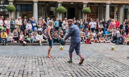 covent: London, England, August 20, 2015: Street performer works with audience member to engage onlookers, Covent Garden