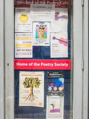 current events: London, England, August 20, 2015: Doorway of the Poetry Cafe, with posters and flyers listing current events and opportunities