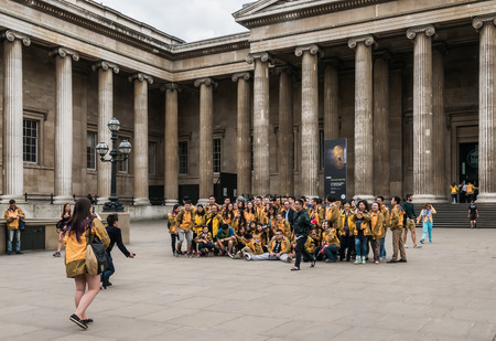 british museum: London, England, August 23, 2015: Asian tour group poses for group photo outside the British Museum Editorial
