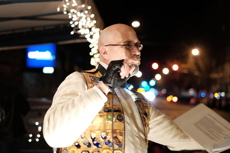 announcing: Corvallis, OR, Nov 28, 2015: Closeup of Lions Club emcee in decorated vest announcing holiday parade