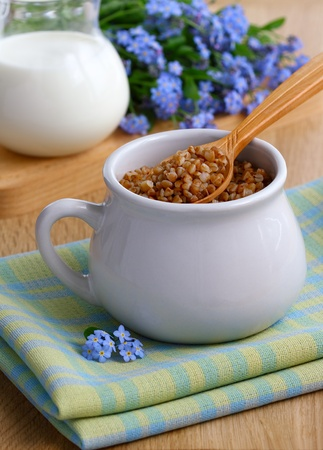 Buckwheat and milk in a rustic style on the table Stock Photo - 9600066