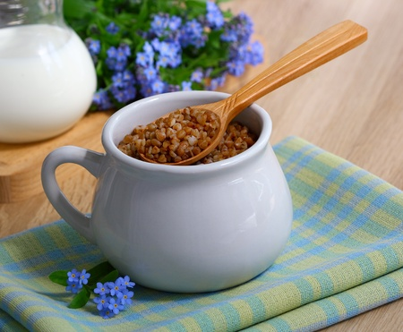 Buckwheat and milk in a rustic style on the table Stock Photo - 9600067