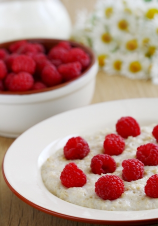 Oatmeal with berries on the table photo