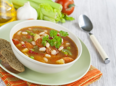 Vegetable soup with beans and celery on the table photo