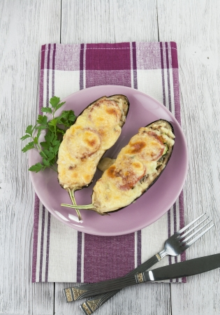 Eggplant baked with vegetables and cheese on the table Stock Photo - 21808099