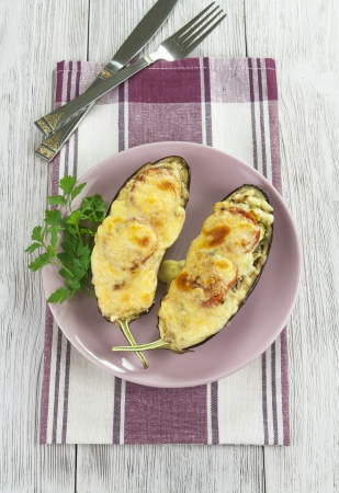 Eggplant baked with vegetables and cheese on the table Stock Photo - 21808102