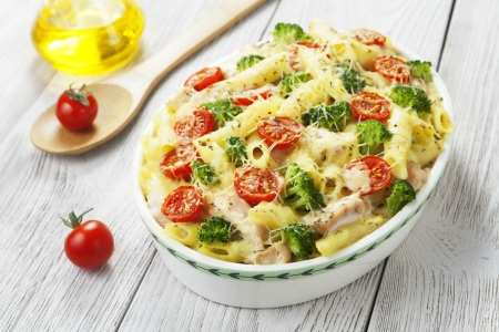 Casserole pasta with chicken and broccoli on the table Stock Photo