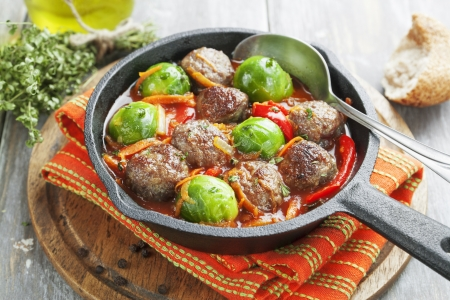 Meatballs with Brussels sprouts in tomato sauce