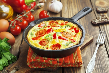 frying pan: Omelet with vegetables and cheese. Frittata in a frying pan  Stock Photo