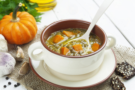 meatless: Green lentil soup with pumpkin in the bowl