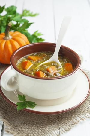 green lentil: Green lentil soup with pumpkin in the bowl