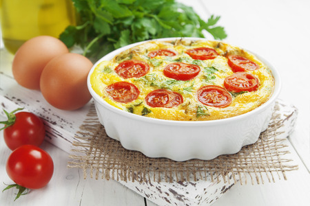 Omelet with vegetables and cheese. Frittata in the ceramic pot