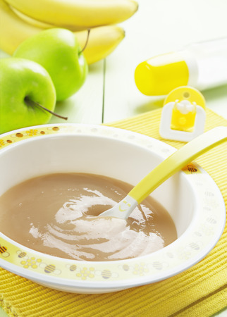 teat: Fruit puree in a bowl on the table, baby food