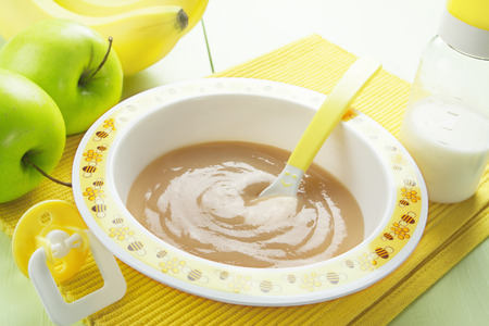 pureed: Fruit puree in a bowl on the table, baby food