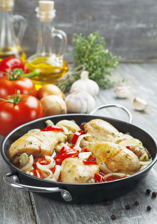 Fricassee of chicken with vegetables in the pot photo