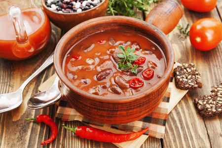 Chili soup with red beans and greens. Mexican cuisine Stock Photo