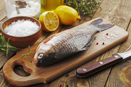 crucian: Fresh fish crucian on a wooden table Stock Photo
