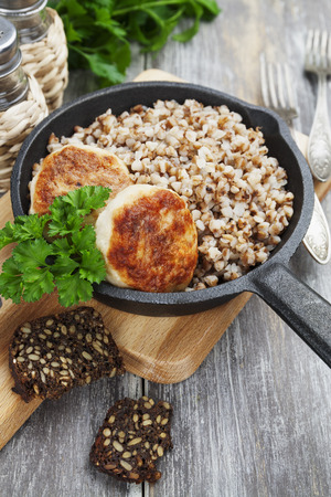 cast iron: Chicken burgers and buckwheat in a cast iron frying pan