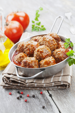 Meatballs in tomato sauce in the pan photo