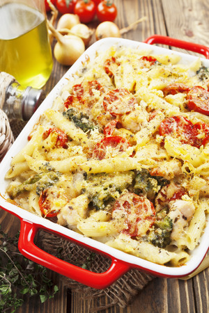 Casserole pasta with chicken and broccoli on the table photo