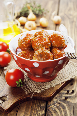 Meatballs in tomato sauce in the ceramic bowl Stock Photo - 38376419
