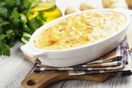 potato: Potato casserole with meat on the wooden table Stock Photo