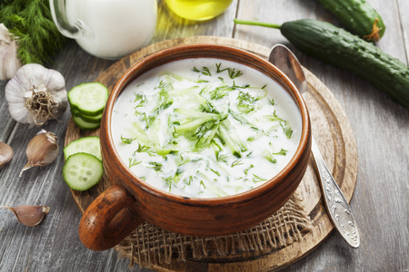 cold soup: Cold soup with cucumbers, yogurt and fresh herbs on the table