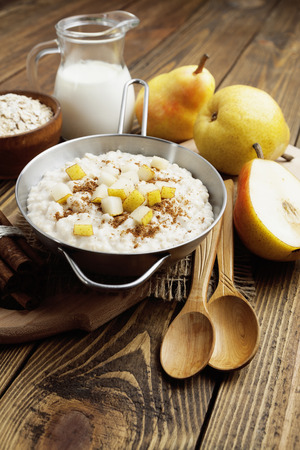 Oatmeal with caramelized apples in the metal bowl photo