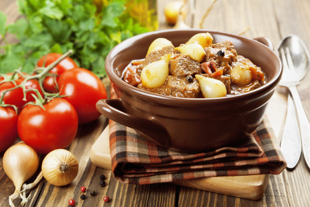 Stifado. Stewed beef with onions and tomatoes
