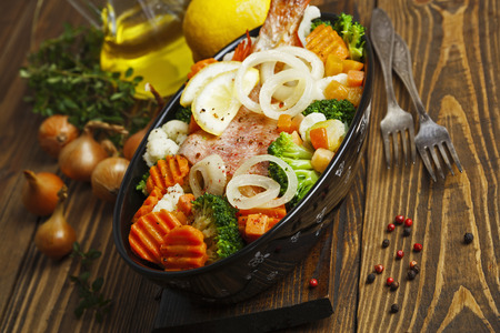redfish: Fried fish with vegetables in the  pot Stock Photo
