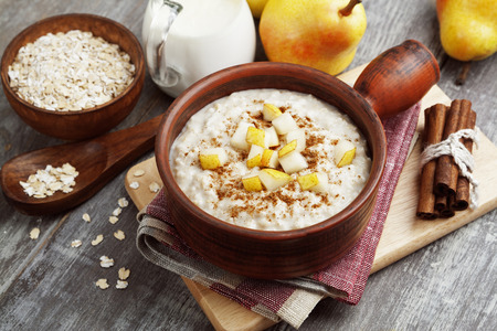 Porridge with pear and cinnamon in the bowl Stock Photo