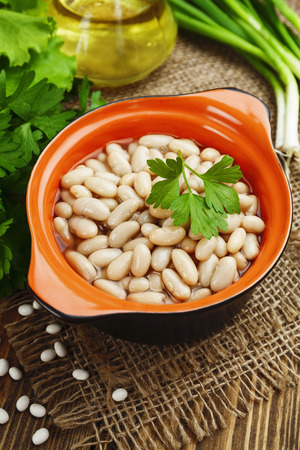 meatless: Bean stew in the ceramic pot on a table