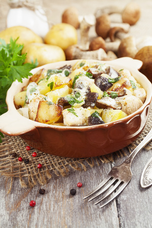 sour cream: Potatoes with mushrooms in sour cream on the dining table Stock Photo