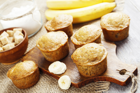 banana slice: Homemade banana muffins on the wooden table Stock Photo