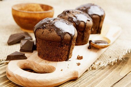 muffin: Muffins with chocolate on a wooden table Stock Photo