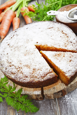 powdered: Carrot pie with powdered sugar on the table