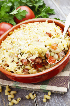second breakfast: Casserole with pasta, bacon, green peas and mustard Stock Photo