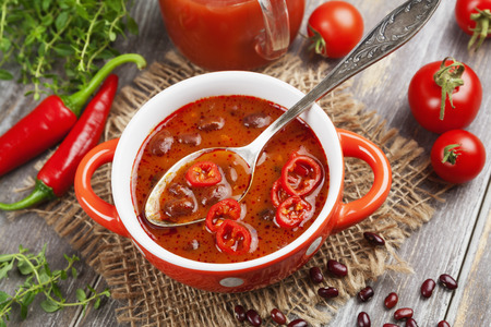 red chili pepper: Soup with red bean and chili pepper. Mexican cuisine