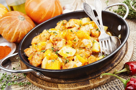 baked meat: Goulash with pumpkin and turkey in frying pan