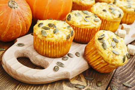 Homemade pumpkin muffins on the wooden table Stock Photo