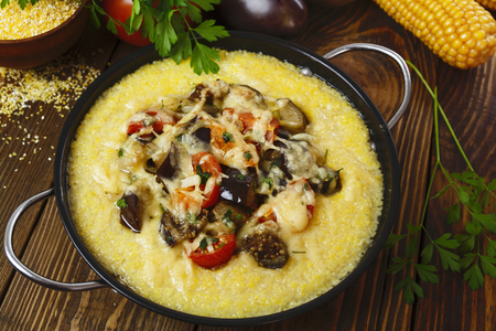 second meal: Polenta baked with vegetables and cheese on the table