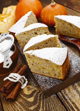 good food: Cake with pumpkin, cinnamon and powdered sugar Stock Photo