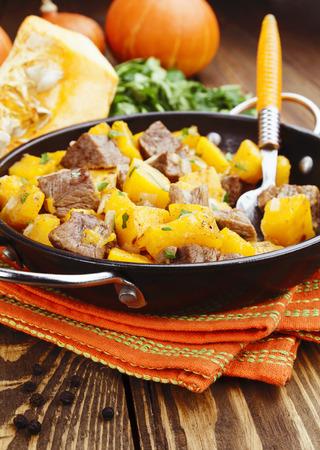 stew pan: Stew beef with pumpkin in a frying pan