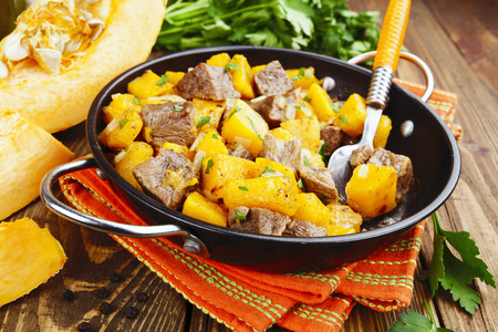 second meal: Stew beef with pumpkin in a frying pan