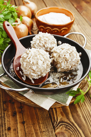 second meal: Meatballs with rice on the frying pan Stock Photo
