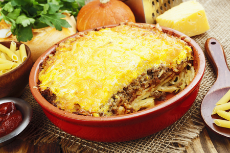second breakfast: Casserole with pasta, minced meat and pumpkin in a ceramic pot